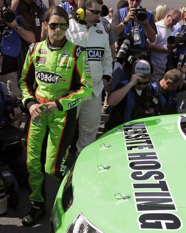 Danica Patrick walks around her car before the