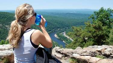 A hiker takes in the expansive view of