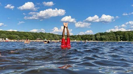 A swimmer performs aquabatics at Harriman State Park,