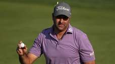 Marc Turnesa reacts to a putt on the