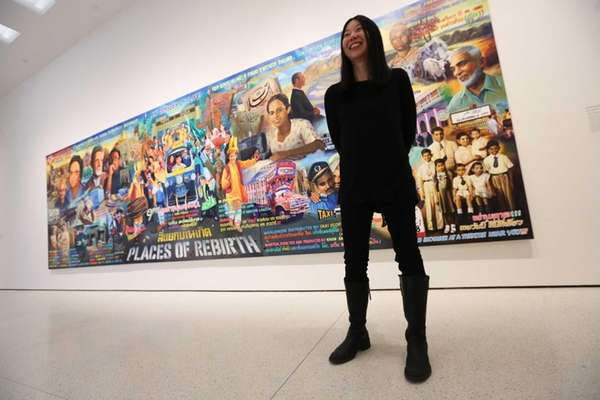 Curator June Yap stands in front of a