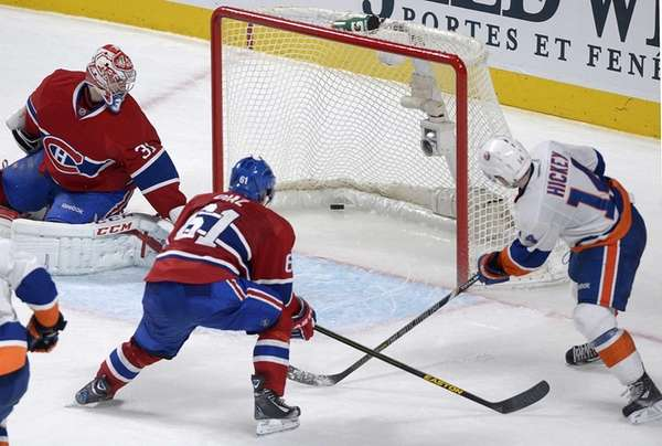 Islanders' Thomas Hickey scores the game winner against