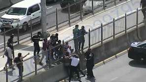 Someone wielding a stick struckthree NYPD officers who