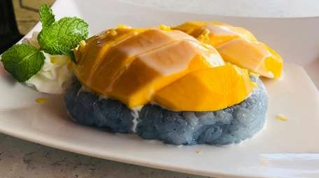 Mango with butterfly pea-infused sticky rice at Thai