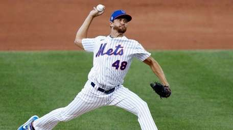 Jacob deGrom #48 of the Mets pitches during
