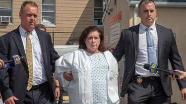 Faye Doomchin leaves Nassau police headquarters in August,