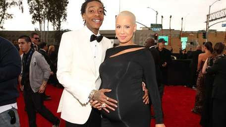 Rapper Wiz Khalifa and model Amber Rose attend