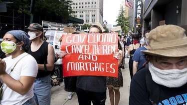 Demonstrators call for rent relief outside of a