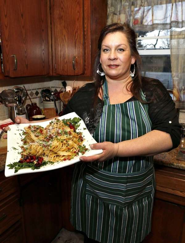 Lisa Cocchi of Brentwood holds a dish tagliatelle