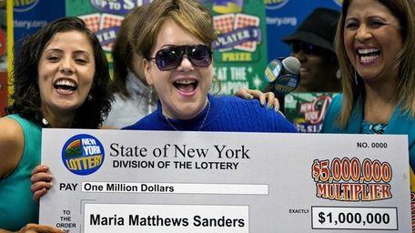 Maria Matthews Sanders, of Commack, holds her facsimile
