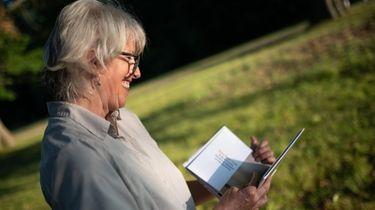 Nature photographer and author Vicki Jauron turns through