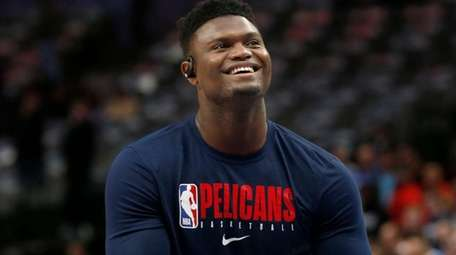 New Orleans Pelicans forward Zion Williamson shoots free