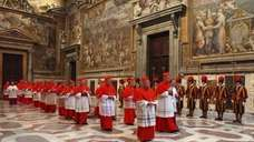Cardinals walking in procession to the Sistine Chapel
