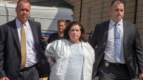 Faye Doomchin leaves Nassau County Police headquarters in