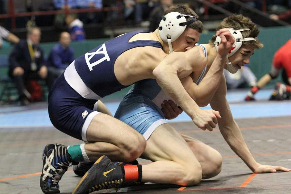Eastport-South Manor's Travis Passaro takes a hit to
