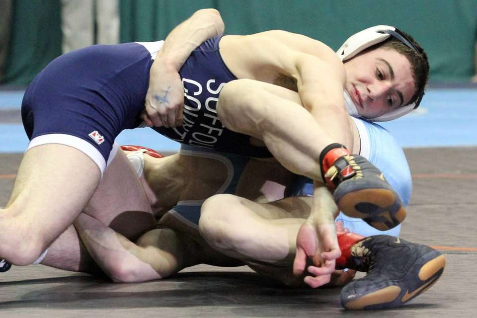 Eastport-South Manor's Travis Passaro goes for a take