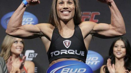 Mixed martial arts fighter Liz Carmouche poses at