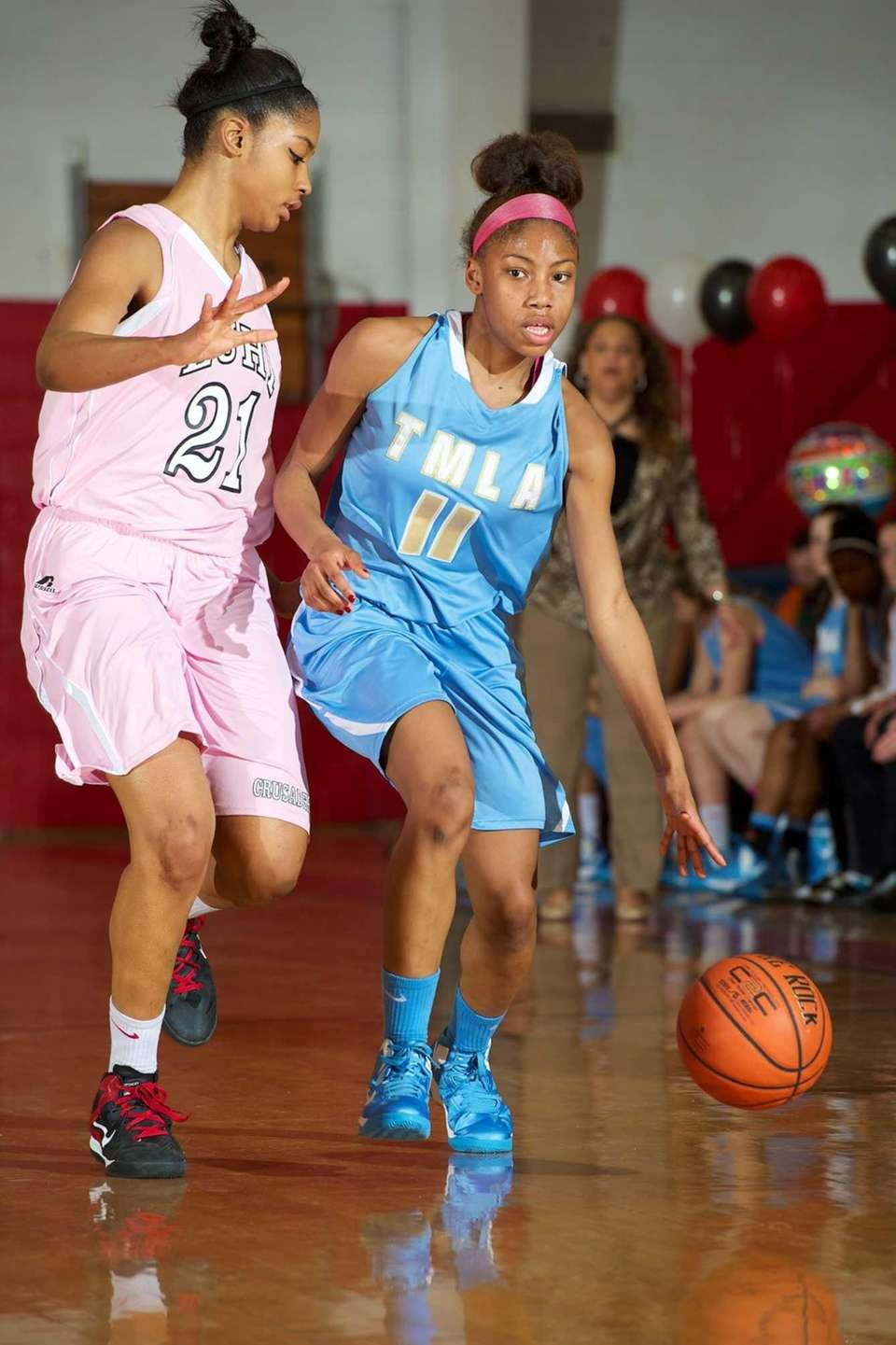 Mary Louis Academy forward Kadijah Dickson attempts to