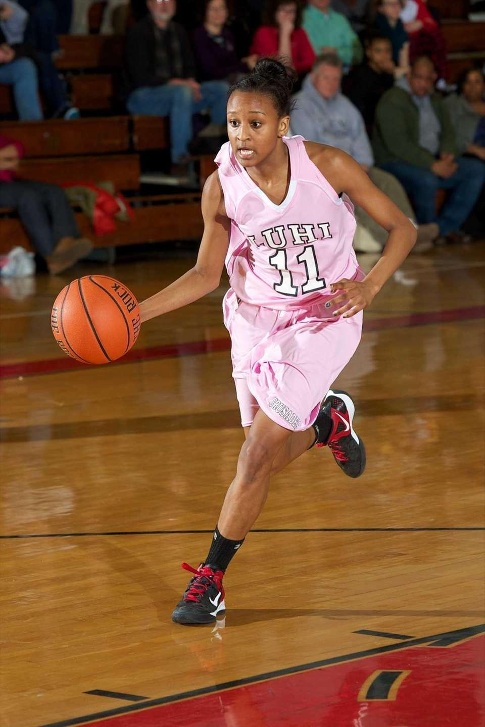 Long Island Lutheran guard Nani Redford drives to