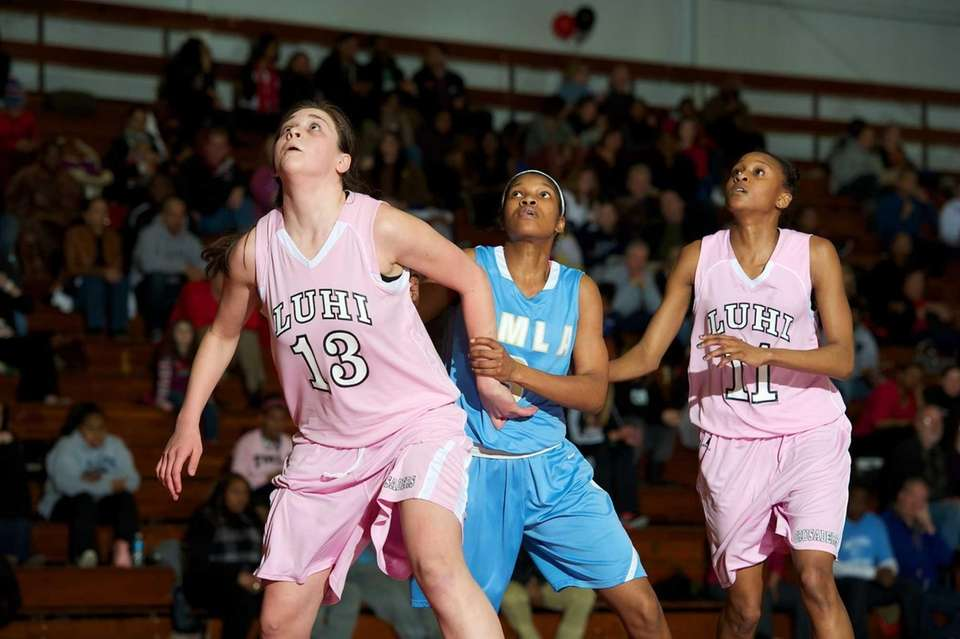 Mary Louis Academy guard Simone Hobdy is boxed
