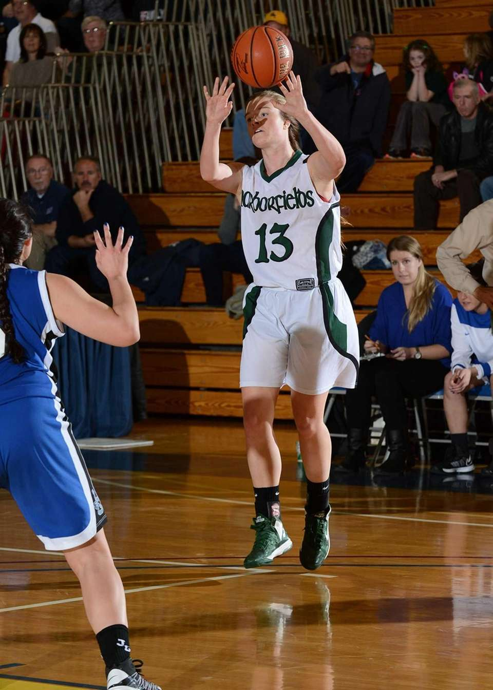 Harborfields' Amy Werbitsky goes up for a jump