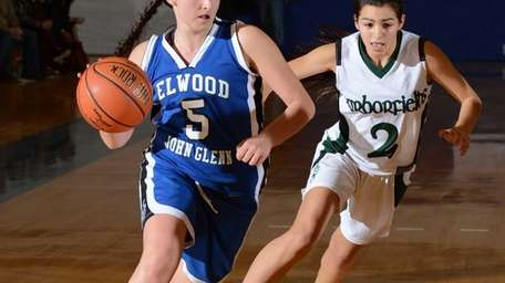 Glenn's Mackenzie Sivilli drives hard to the basket