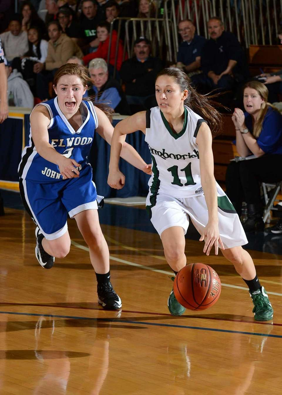 Harborfields' Allie Tunick brings the ball up against