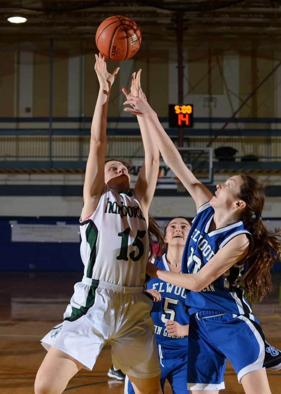 Glenn's Alexis Groark and Harborfields' Kristen Kelly battle