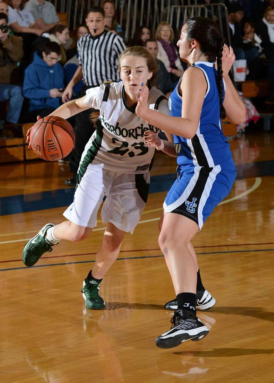 Harborfields' Toni Deren drives hard to the basket
