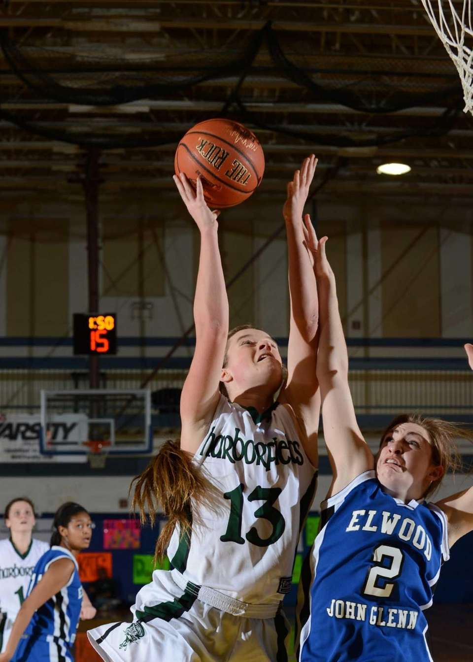 Harborfields' Amy Werbitsky goes up over Glenn's Meaghan