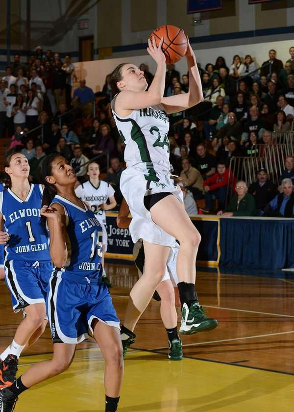 Harborfields' Bridgit Ryan goes up for the layup