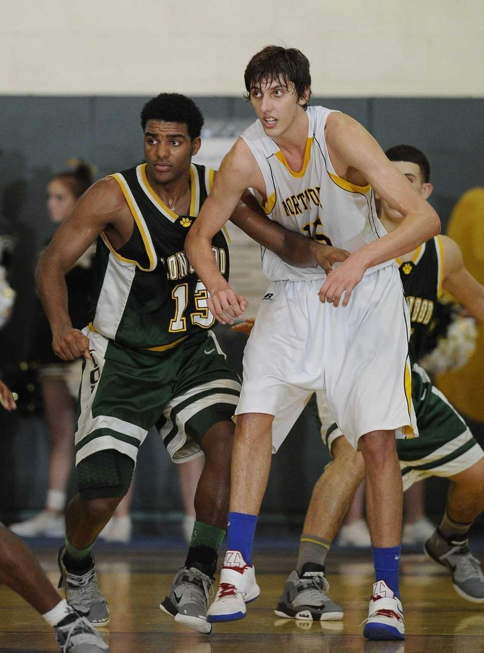 Northport's Luke Petrasek is defended by Longwood's Stephon