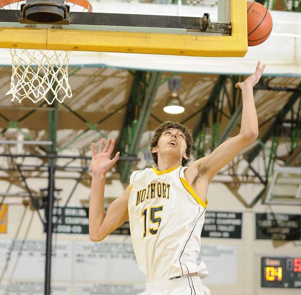 Northport's Luke Petrasek grabs a rebound against Longwood