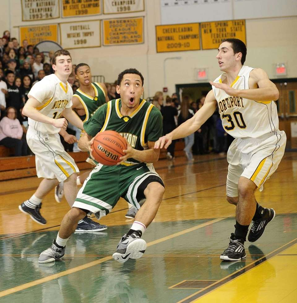 Longwood's Walter Penate drives to the basket ahead