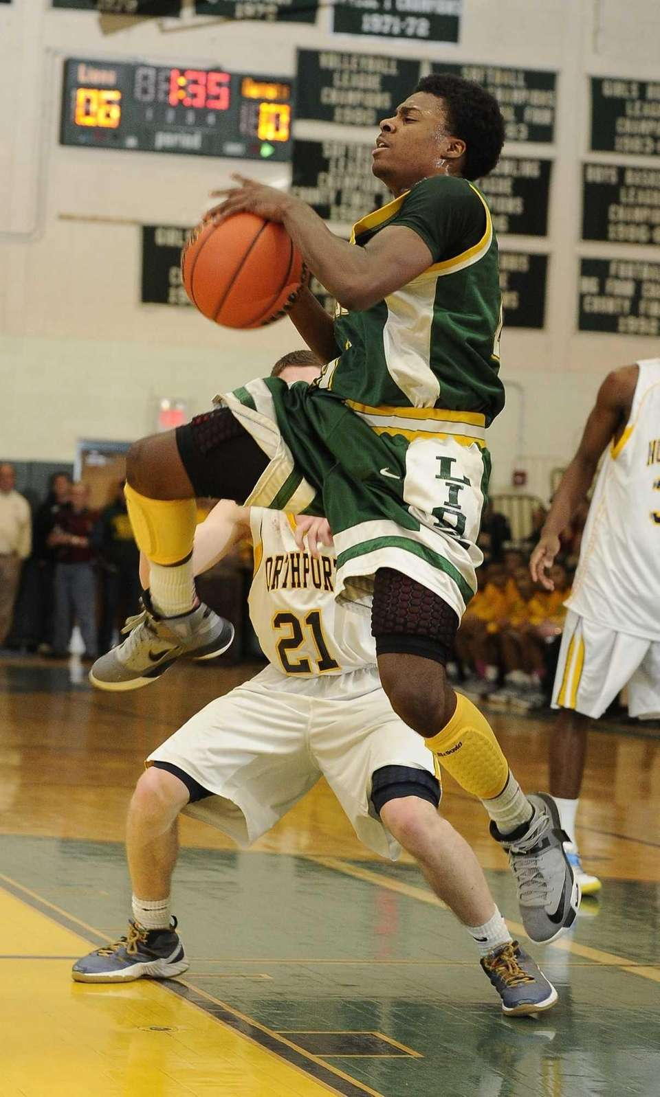 Longwood's Latrell Washington drives against Northport in the