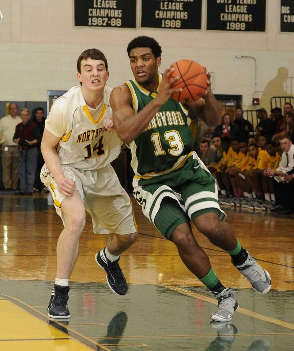 Longwood's Stephon Odle is defended by Northport's Thomas