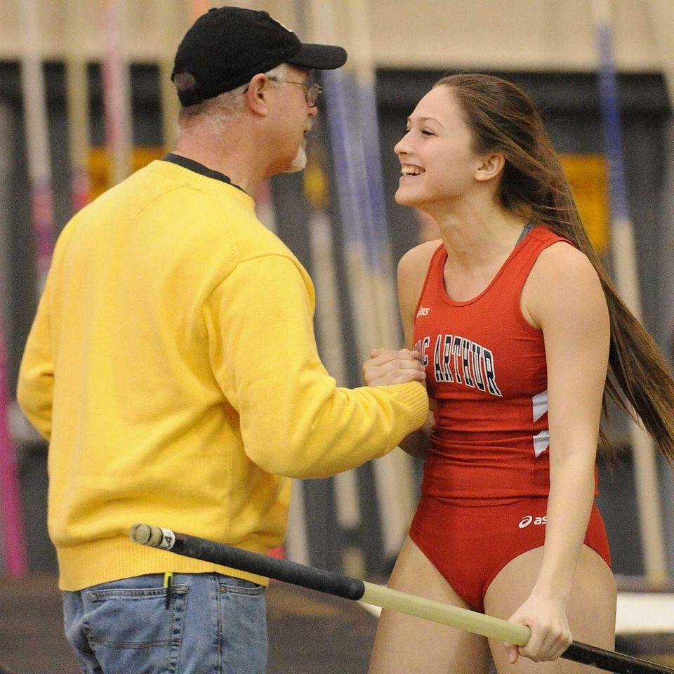 MacArthur High School senior Nicole Natland gets congratulated