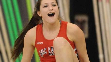 MacArthur High School senior Nicole Natland reacts after