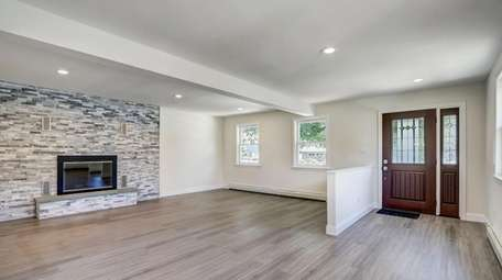 The living room has a stone-face fireplace.