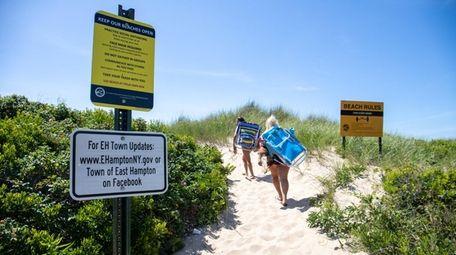 Social distancing rules signs at Kirk Park Beach
