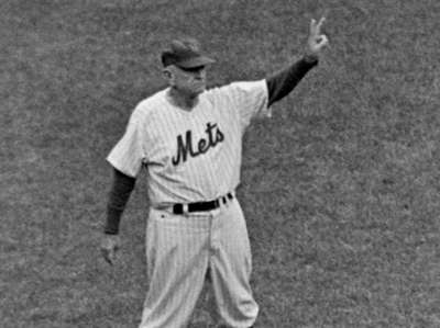 Mets manager Casey Stengel coaching third base in