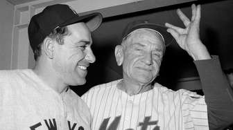 Yankees manager Yogi Berra, left, and Mets manager