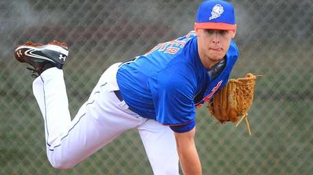 Zack Wheeler delivers a pitch during a spring