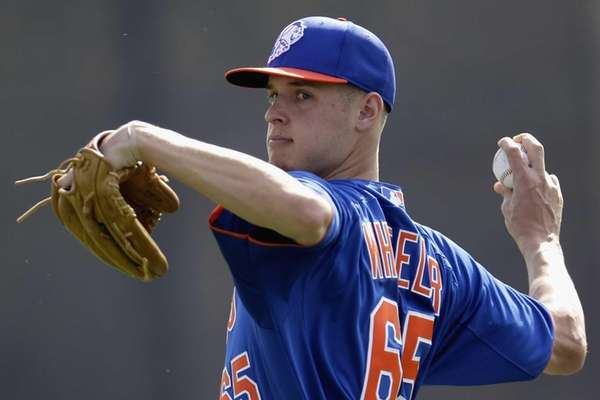 Mets pitcher Zack Wheeler throws during the team's