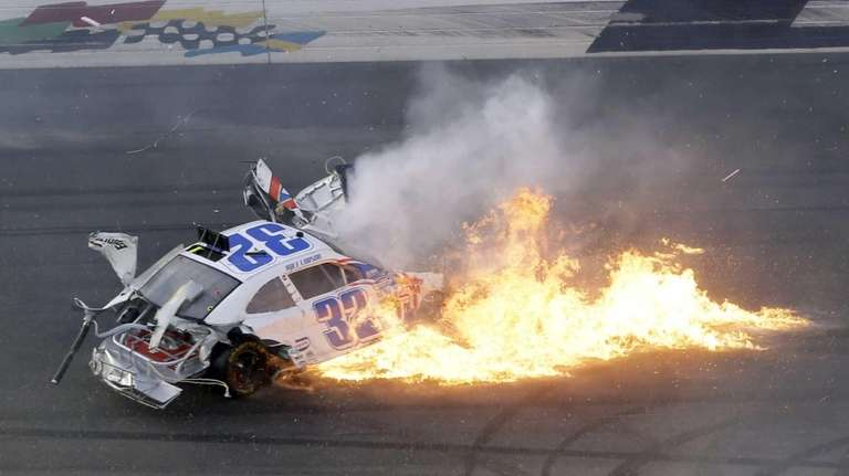 Kyle Larson's car leaves a trail of flames