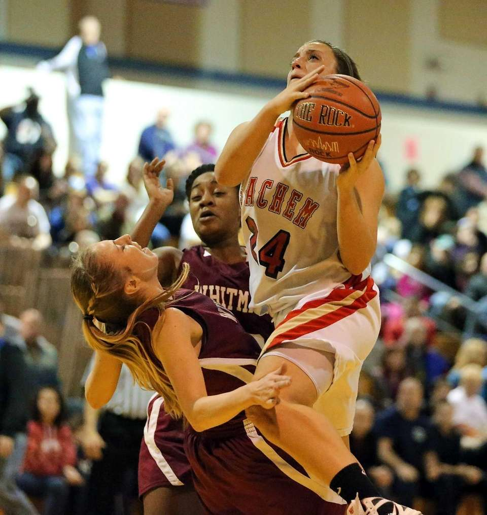 Sachem East's Emily Carmel (24) drives the paint