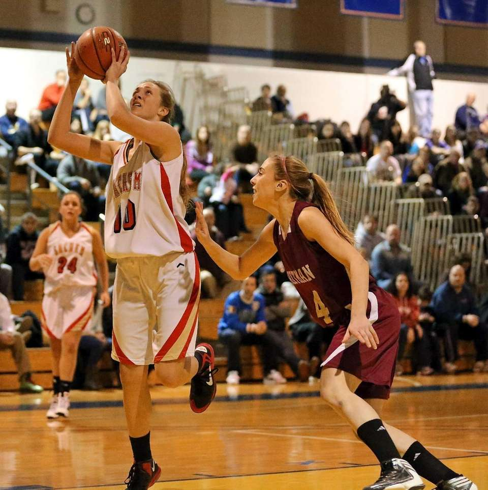 Sachem East's Kathleen Everson (10) puts up the