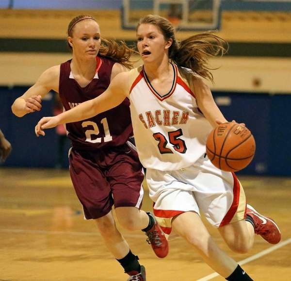 Sachem East's Katie Doherty (25) drives the outside