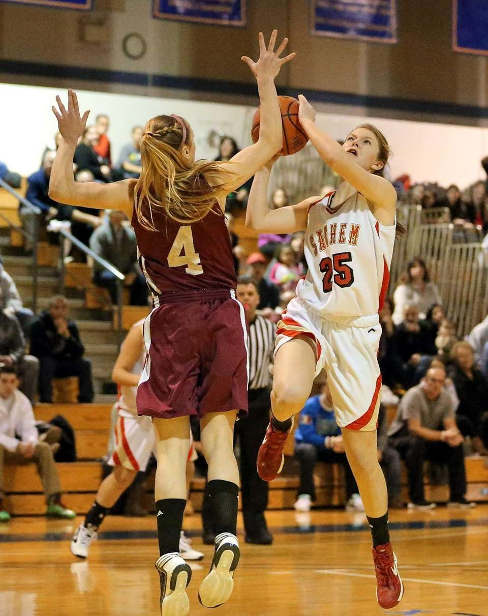 Sachem East's Katie Doherty (25) puts up a