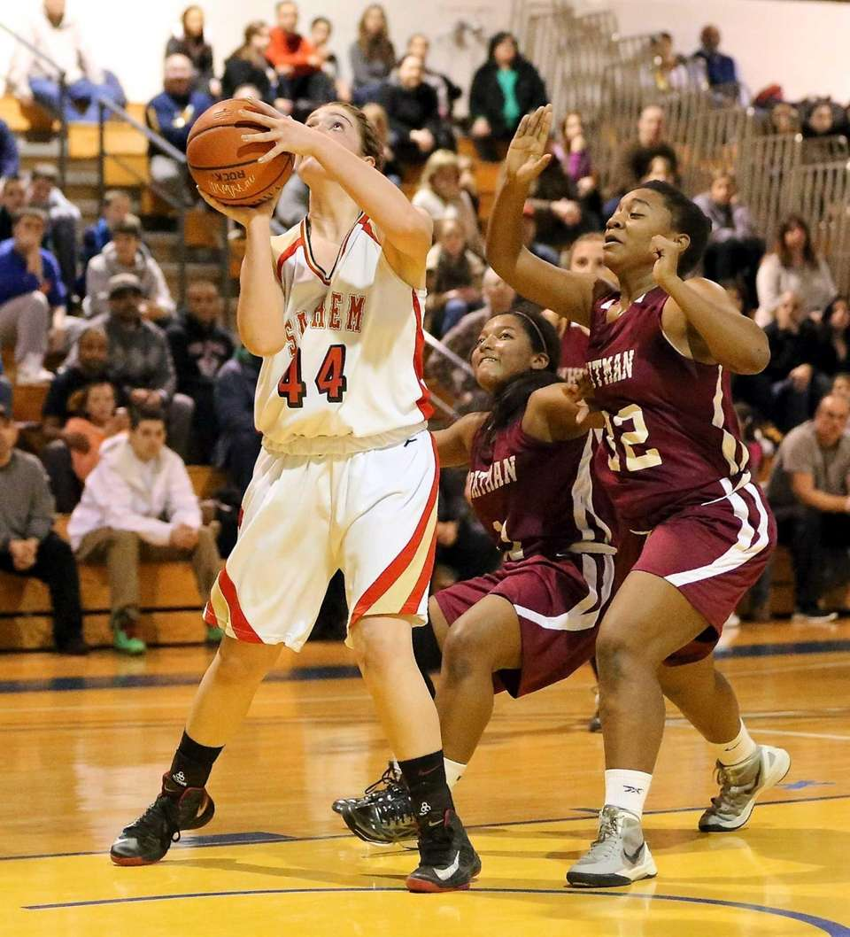 Sachem East's Allie Drake (44), puts up the